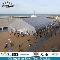 China Large Aluminum Frame TFS Curved Tents Outdoor Warehouse Tent 75kg/Sqm supplier